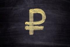 在黑黑板背景的拉长的卢布标志 免版税图库摄影