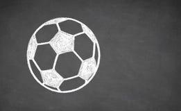 在黑板画的足球 免版税库存图片