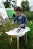 在画架的儿童绘画 图库摄影