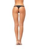 在黑比基尼泳装内裤的女性靶垛 免版税图库摄影