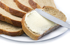 在黄油上添面包 库存图片