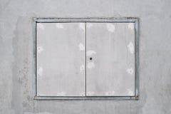 在水泥墙壁上的Windows框架 库存照片