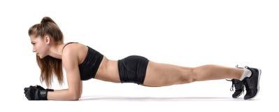 在锻炼板条期间时,保险开关健身女孩,当 免版税库存图片