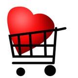 在购物台车的红色心脏 免版税图库摄影