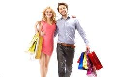在购物的快乐的夫妇 图库摄影