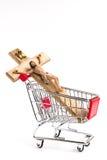 在购物车的耶稣受难象 免版税库存照片