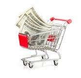 在购物车的金钱 免版税库存图片