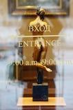 在玻璃后的古铜色小雕象 免版税图库摄影