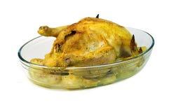 在玻璃板的鸡在白色背景 免版税库存照片