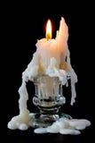 在玻璃烛台的灼烧的蜡烛 免版税图库摄影
