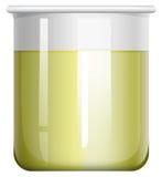 在玻璃烧杯的黄色液体 免版税库存图片