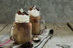 在玻璃瓶子的冷的咖啡饮料 免版税库存图片
