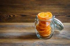 在玻璃瓶子的糖煮的桔子 库存照片