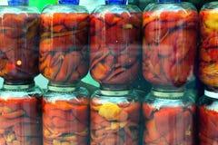 在玻璃瓶子的红辣椒 图库摄影