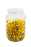 在玻璃瓶的软的胶凝体胶囊 免版税库存照片