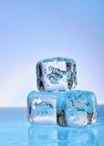 在玻璃的三个冰块 免版税库存图片