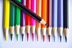 在玻璃的五颜六色的铅笔在白色背景 库存照片