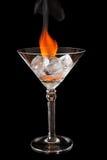 在玻璃的冰块与发光的黑表面上的火焰 免版税库存图片