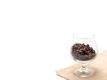 在玻璃的咖啡豆 免版税图库摄影