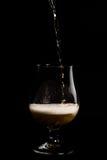 在玻璃的啤酒 免版税图库摄影