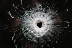 在玻璃的大弹孔 免版税库存照片