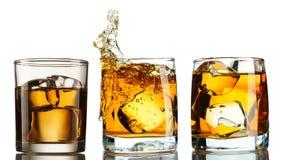 在玻璃的威士忌酒与冰集合 图库摄影
