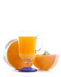 在玻璃的新鲜的南瓜汁 图库摄影