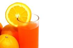 在玻璃的新鲜的橙汁 图库摄影