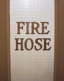 在玻璃的灭火水龙带 库存图片