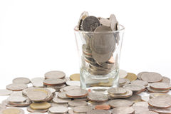 在玻璃的硬币与人贪婪是可比较的  免版税库存照片