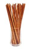 在玻璃的筷子在白色背景 免版税库存照片