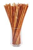 在玻璃的筷子在白色背景 免版税库存图片