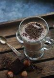在玻璃的自创巧克力牛奶震动在木背景 免版税库存照片