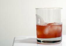 在玻璃的蔓越桔鸡尾酒 库存照片