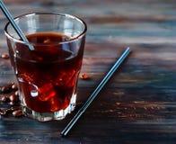 在玻璃的被冰的咖啡 图库摄影