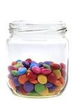 在玻璃的颜色圆的糖果 库存照片