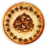 在玻璃碗的烤松果Hummus。 免版税图库摄影