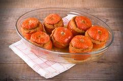 在玻璃碗的西红柿原料 免版税图库摄影