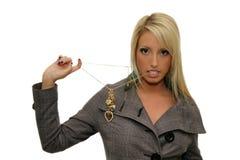 在嘴的妇女垂饰 免版税库存照片