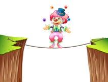 在绳索的小丑玩杂耍的球 皇族释放例证