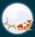 在他的爬犁的圣诞老人飞行 图库摄影