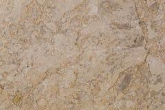 在轻的米黄颜色的自然美丽的大理石 免版税库存图片