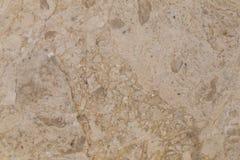 在轻的米黄颜色的自然美丽的大理石 免版税图库摄影
