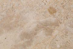在轻的米黄颜色的自然美丽的大理石 图库摄影