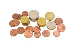 在轻的背景的不同的欧洲硬币 免版税库存照片