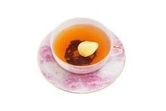 在轻的背景的姜茶 免版税库存照片