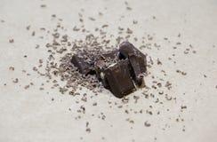 在轻的背景的巧克力块堆 库存图片