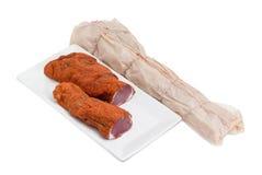 在轻的背景的干猪里脊肉 免版税库存图片