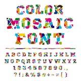 在轻的背景的残破的色的字母表 免版税库存图片