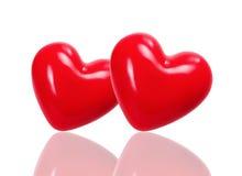 在轻的背景的红色心脏 库存图片